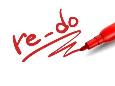 the word re-do with a red marker over white